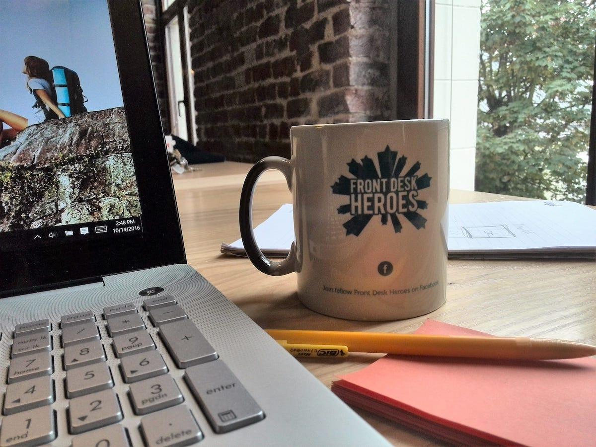 blog-creative-job-titles-front-desk-hero-mug.jpg