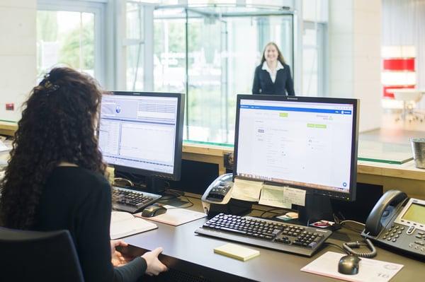 admin receptionist at front desk reception